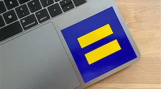 An HRC logo sticker on the corner of a laptop.