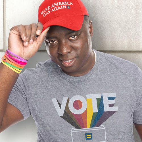 "Person wearing HRC ""Vote"" rainbow tee and a ""Make America Gay Again"" hat"