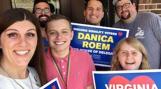 Five volunteers posing with HRC signs