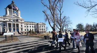 People walking up to government buildings in South Dakota