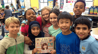 """A diverse group of children holding up a book titled """"I Am Jazz"""""""