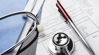 Stethoscope sitting on medical records