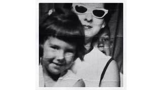 Joni Madison as a young girl and her mom in a photo booth
